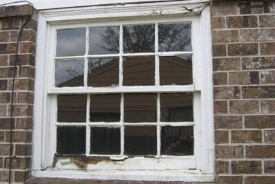 white window with deteriorating frame