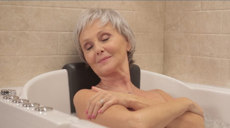 Woman relaxing in tub